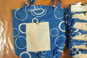 Bolsa enrollable azul